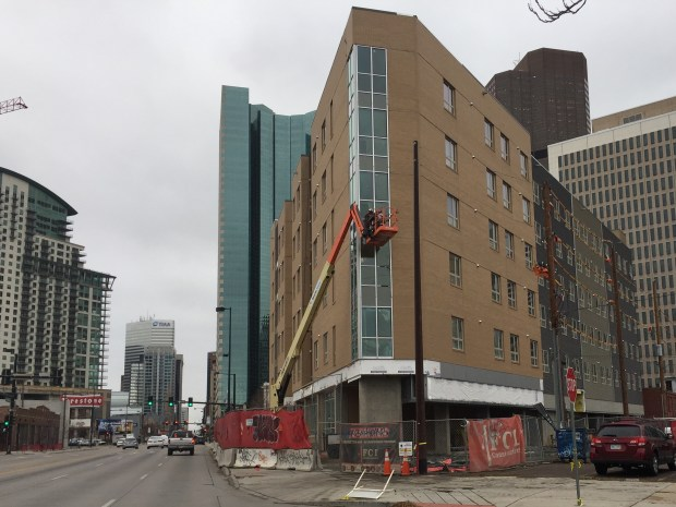 A 100-unit apartment building is under construction for the Colorado Coalition for the Homeless at Stout Street and Broadway in downtown Denver, as seen Oct. 30, 2017. It will provide more housing units for Denver's social impact bond-funded homeless initiative.