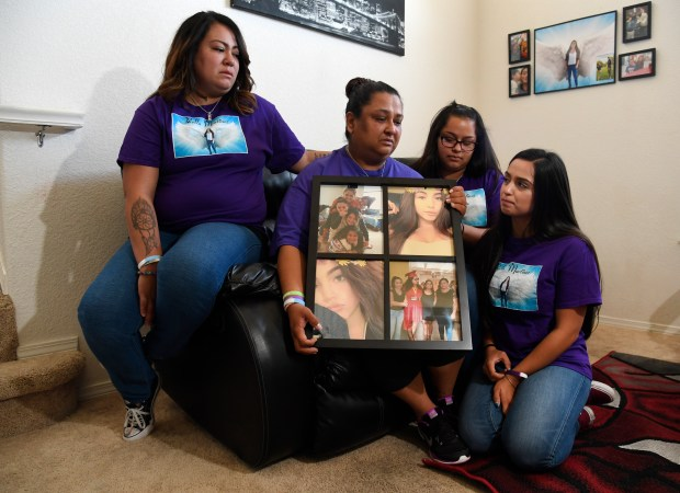 Melissa Martinez, surrounded by her daughters, ...