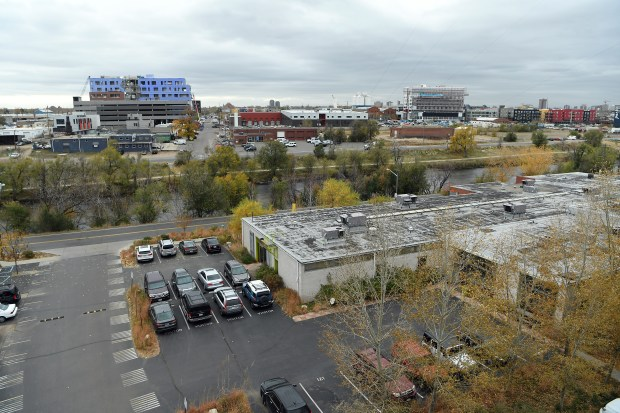An overhead photo shows where the River North Art Bridge might be built in 2018. The photo was taken from atop the roof of Taxi ll on October 26, 2017, looking southeast across the South Platte River. the Great Divide Brew