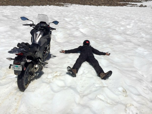 We didn't expect to see snow in July, even at 12,000 feet. Abhi expressed his enthusiasm by riding the Kawasaki directly into a drift, then lying down next to it.
