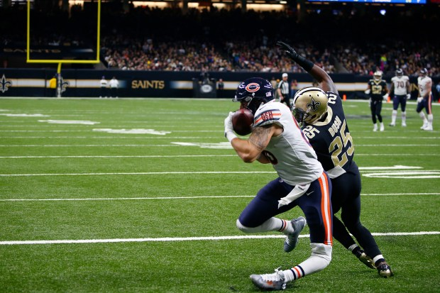 EDS NOTE: GRAPHIC CONTENT - Chicago Bears tight end Zach Miller (86) injures his leg as pulls in a touchdown reception, that was ruled incomplete upon review, as New Orleans Saints defensive back Rafael Bush (25) covers, in the second half of an NFL football game in New Orleans, Sunday, Oct. 29, 2017. (AP Photo/Butch Dill)