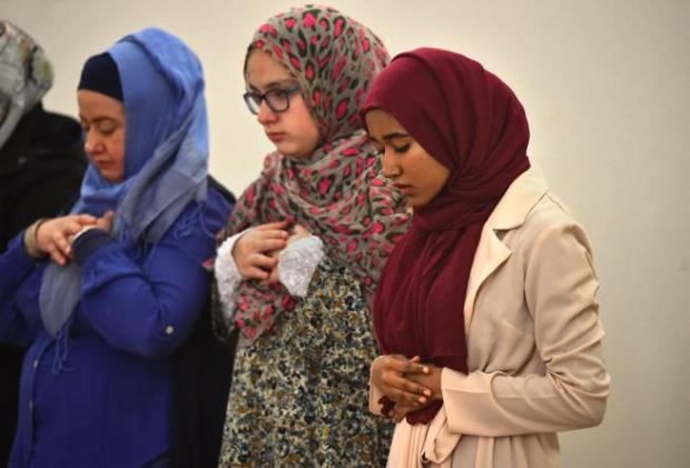 Heraa Hashm, right, president of the Muslim Student Association at the University of Colorado's Boulder campus, prays during services at the Islamic Center of Boulder on Nov. 17. Praying with Hashm are, from left to right, Serap Kaui and her daughter Sana Kaui