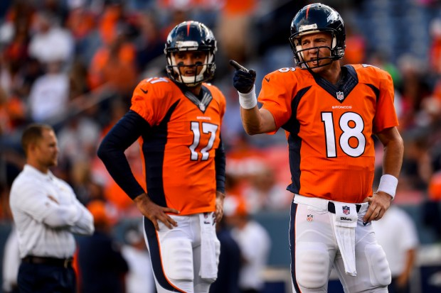 Peyton Manning (18) and Brock Osweiler ...