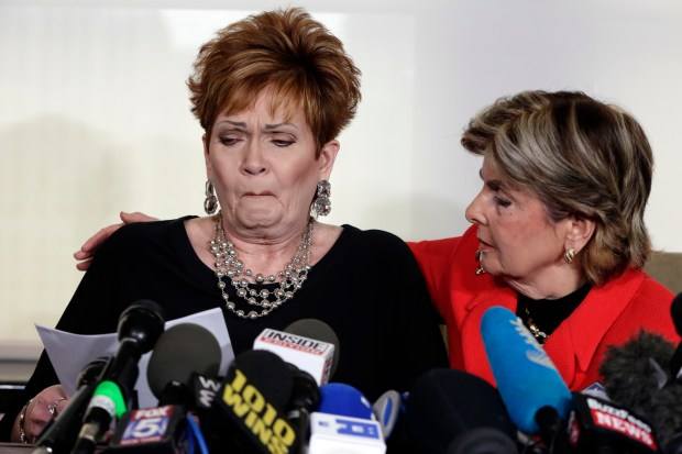 Beverly Young Nelson, left, the latest accuser of U.S. Senate candidate Roy Moore, reads her statement as attorney Gloria Allred looks on during a news conference, in New York on Monday. Nelson says Moore assaulted her when she was 16 and he offered her a ride home from a restaurant where she worked.