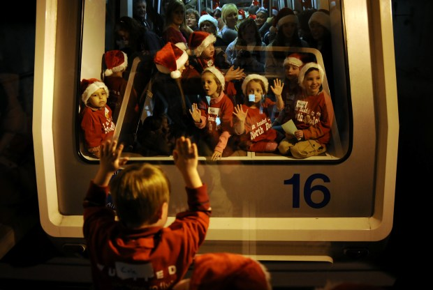 Children from Starlight Children's Foundation ride the train at Denver International Airport to catch their United Airlines flight to visit Santa Claus at the North Pole on Dec. 10, 2009. The children were given a boarding pass to take the flight.