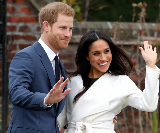 Prince Harry and Meghan Markle wave to photographers as they announce their engagement on Monday in London.