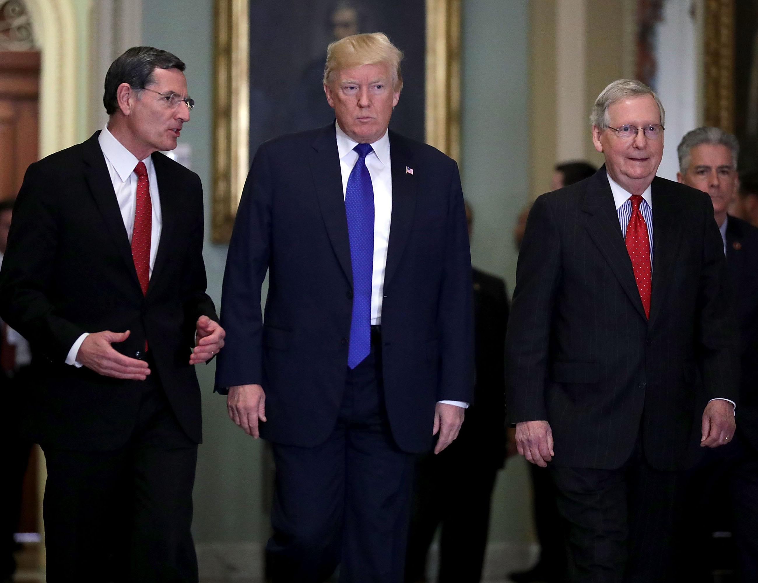 Republicans push tax bill forward, Trump hails GOP 'love fest'