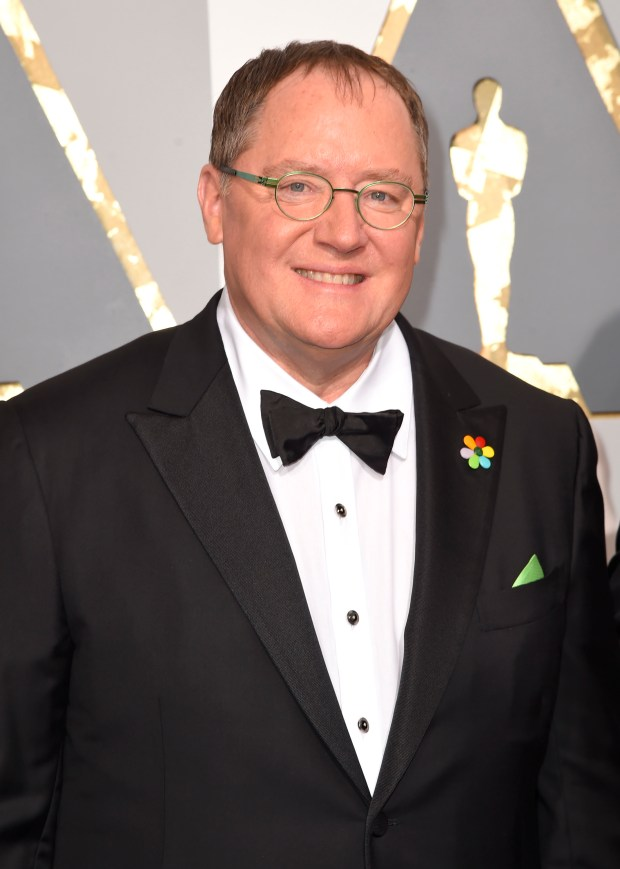 """In this Feb. 28, 2016 file photo, Pixar co-founder and Walt Disney Animation chief John Lasseter arrives at the Oscars in Los Angeles. Lasseter is taking a six-month leave of absence citing """"missteps"""" with employees. (Photo by Dan Steinberg/Invision/AP, File)"""