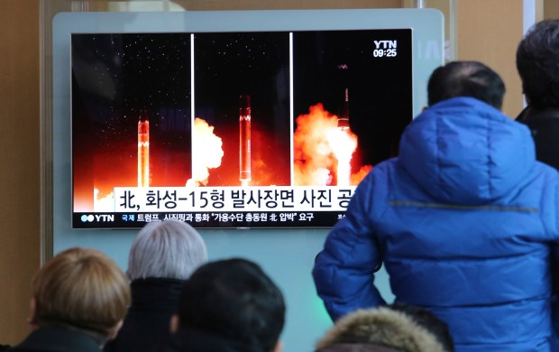 "People watch a TV screen showing a local news program reporting about North Korea's missile launch, at the Seoul Railway Station in Seoul, South Korea, Thursday, Nov. 30, 2017. After 2 ½ months of relative quiet, North Korea launched its most powerful weapon yet early Wednesday, claiming a new type of intercontinental ballistic missile that some observers believe could put Washington and the entire eastern U.S. seaboard within range. The signs read ""North Korea opened pictures of the Hwasong-15 missile."""