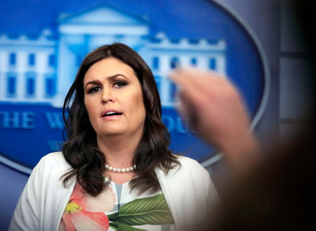 White House press secretary Sarah Huckabee Sanders talks to reporters during a press briefing in the Brady Press Briefing Room at the White House on Monday.