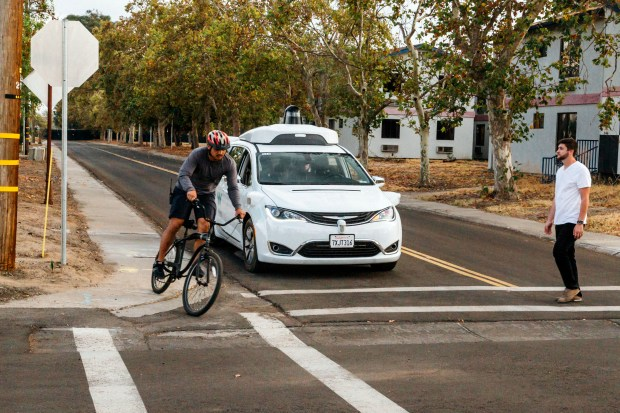 A Chrysler Pacifica minivan equipped with Waymo's self-driving car technology is tested at Waymo's facility in Atwater, Calif., on Oct. 29.