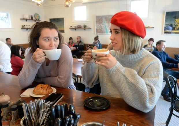 Qwynne Remeny, left, and Emma Zeck, have breakfast at the Alpine Modern Cafe on Thursday morning. Boulder's Alpine Modern Cafe is going cashless at its two locations, potentially one of the first biz to do so in Boulder.