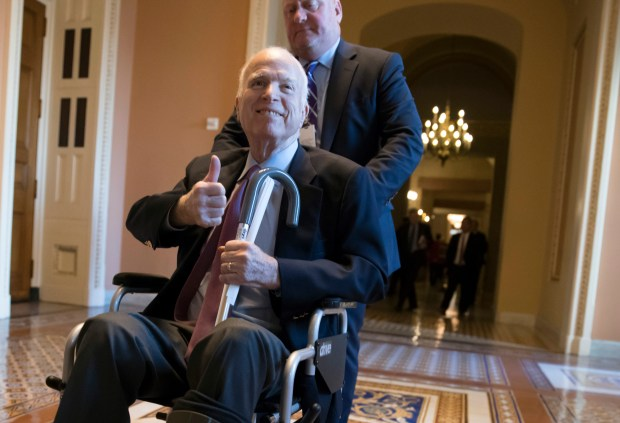 Sen. John McCain, R-Ariz., leaves a closed-door session where Republican senators met on the GOP effort to overhaul the tax code on Dec. 1 at the U.S. Capitol.