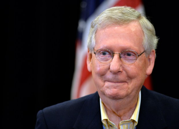 Senate Majority Leader Mitch McConnell holds a news conference Saturday in Louisville, Ky. The Senate passed the Republican tax bill early Saturday morning with a 51-49 vote.