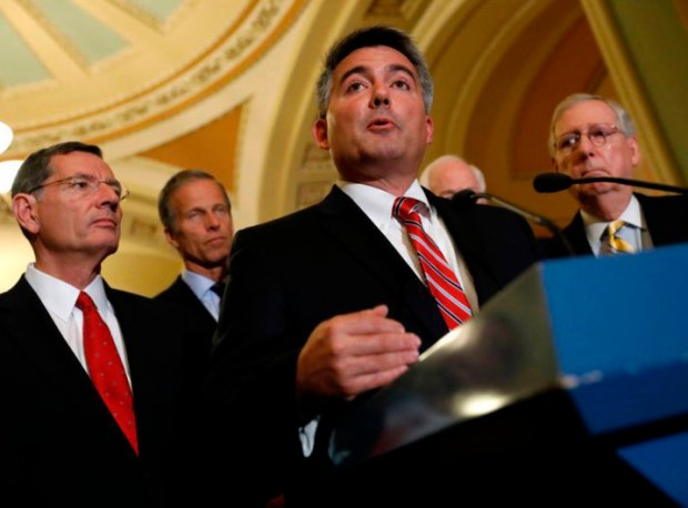 Sen. Cory Gardner, R-Colo., speaks with reporters at the U.S. Capitol on Dec. 6. During Roy Moore's run for the Senate in Alabama, Gardner opposed Moore, then backed him, then called for his expulsion.