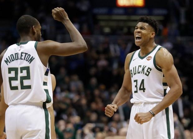 Milwaukee Bucks' Giannis Antetokounmpo celebrates with ...