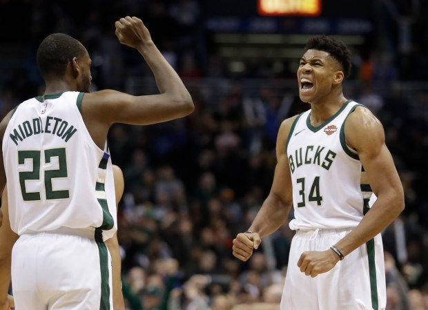 Milwaukee Bucks' Giannis Antetokounmpo celebrates with ...