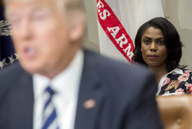 Omarosa Manigault, White House director of communications for the Office of Public Liaison, sits behind President Donald Trump on Feb. 14 at the White House. Manigault, a reality TV star turned political operative, is set to leave the Trump administration early next year.