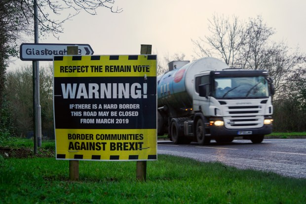 """A truck drives past an """"anti-Brexit"""" ..."""