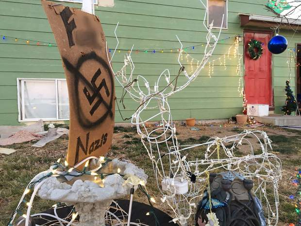 "This photo, which has been altered to obscure the ""F-word,"" shows a sign on display outside an east Greeley home that has caused a controversy."