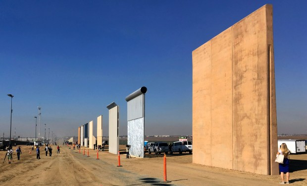 Prototypes of border walls are displayed in San Diego on Oct. 26. The Trump administration has proposed spending $18 billion over 10 years to significantly extend the border wall with Mexico.