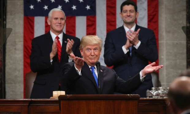 President Donald Trump gestures as delivers his first State of the Union address Tuesday night before a joint session of Congress in the House chamber of the U.S. Capitol.