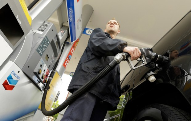 An attendant pumps gas at a station in Portland, Ore., on May 6, 2015. An Oregon law passed nearly seven decades ago banned drivers from pumping their own gas, but now that's changing, in some cases. The new year ushered in some modifications to the aging law that makes Oregon only one of two states in the U.S. that places restrictions on self-service gas.