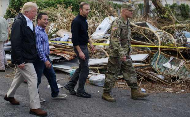 President Donald Trump visits residents affected by Hurricane Maria in Puerto Rico on Oct. 3, 2017.