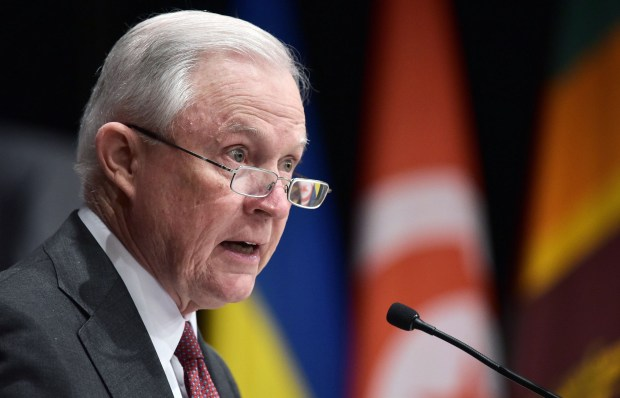 U.S. Attorney General Jeff Sessions speaks on Dec. 4 in Washington, D.C. Sessions is rescinding a policy that had allowed legalized marijuana to flourish without federal intervention across the country.