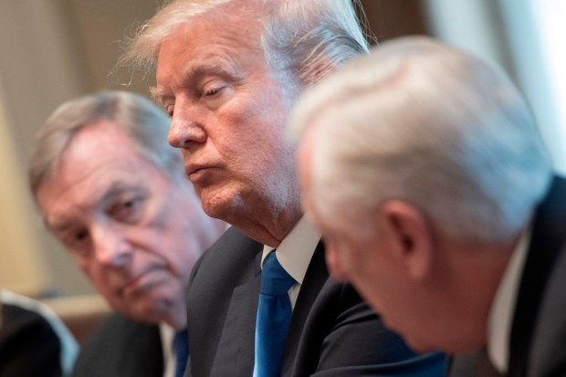 President Donald Trump and Sen. Dick Durbin (left) listen as Rep. Steny Hoyer (right) speaks during a bipartisan immigration meeting at the White House on Jan. 9.