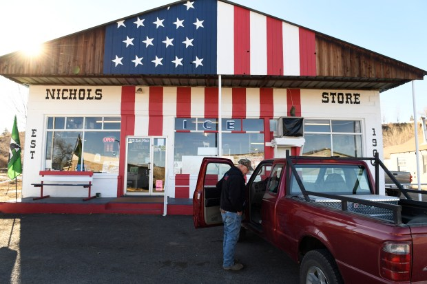 A farmer gets into his truck after shopping at Nichols Store on Dec. 5, 2017 in Rangely.