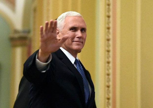 Vice President Mike Pence waves as he walks on Capitol Hill in Washington on Jan. 3. Pence will visit Egypt, Jordan and Israel starting Friday after postponing a trip to the Middle East in December.