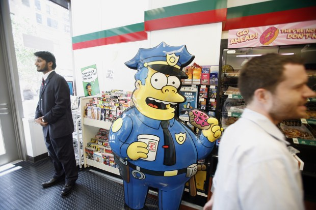 "A cardboard cutout of Chief Wiggum from ""The Simpsons"" is on display at 7-Eleven store in New York City on July 2, 2007."