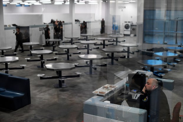 An officer keeps watch at the Pueblo County Detention Center on Dec. 6. The jail, which is currently well beyond capacity, will not be replaced after voters rejected a tax hike to pay for a new facility.