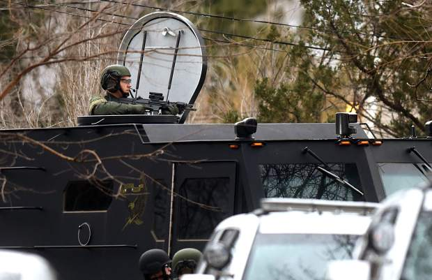 Swat surrounds a home on 22nd Street and 10th Avenue near the University of Northern Colorado in Greeley.