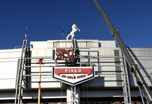 Crews remove the Sports Authority sign from Sports Authority Field at Mile High on Jan. 11. Former Denver Mayor Wellington Webb wants Broncos fans to be able to buy the stadium's naming rights so that Mile High Stadium is once again the sole name of the team's home field.