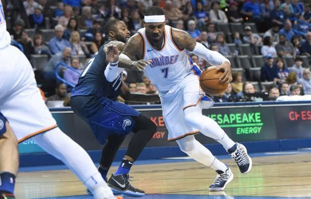 Oklahoma City Thundar's Carmelo Anthony, right, ...