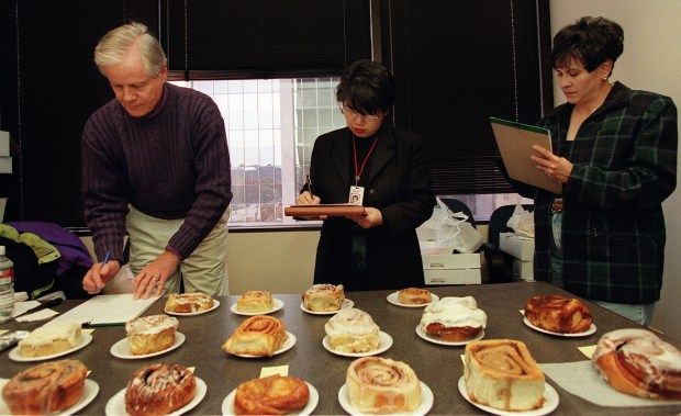 Mike Foster, Hsiao-Ching Chou and Loretta Garcia taste test cinnamon rolls during her time at The Denver Post. (Denver Post file)