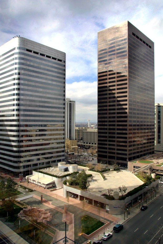 The Bank One building at 1125 17th Street (left) and Seventeenth Street Plaza at 1225 17th St. (right), where Xcel Energy offices, stand on the Denver skyline on Nov. 4, 2004.