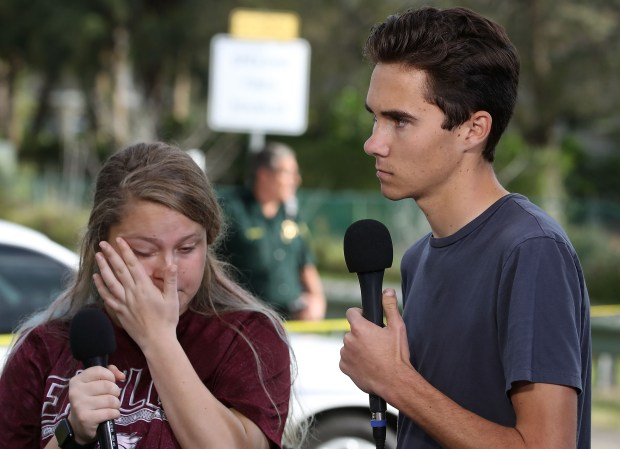 Students Kelsey Friend, left, and David Hogg speak last Thursday about the mass shooting at their school, Marjory Stoneman Douglas High School, in Parkland, Fla.
