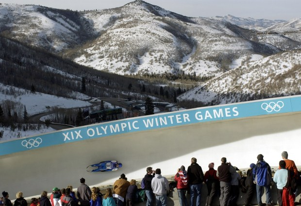 Spectators watch the men's single luge competition during the 2002 Salt Lake City Winter Olympics in Park City, Utah, on Feb. 10, 2002. A committee has begun discussing whether Colorado should place a bid to host the 2026 or 2030 Winter Games.