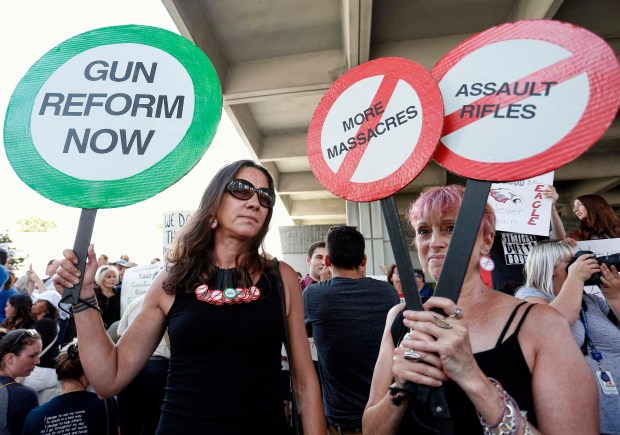Protesters hold signs at a rally for gun control at the Broward County Federal Courthouse in Fort Lauderdale, Fla., on Saturday -- three days after a former student killed 17 people at a high school in Parkland, Fla.