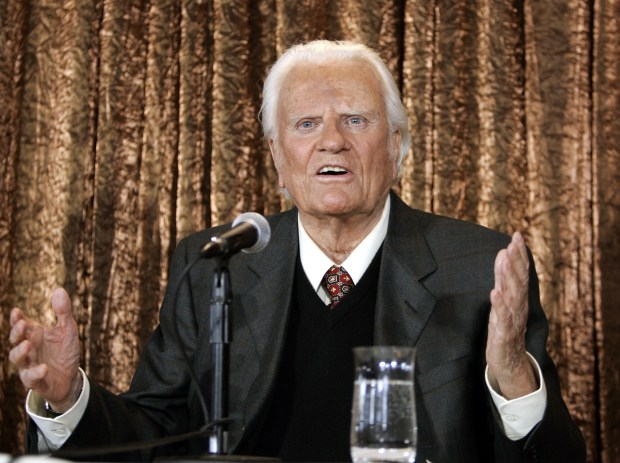Evangelist Billy Graham takes questions at a press conference in New York to announce his Billy Graham Crusade on June 21, 2005. Graham died this week at age 99.