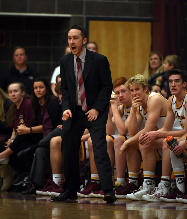 Golden boys basketball coach Erik Buehler yells out from the bench during game against Evergreen on Jan. 24, 2018 in Golden.