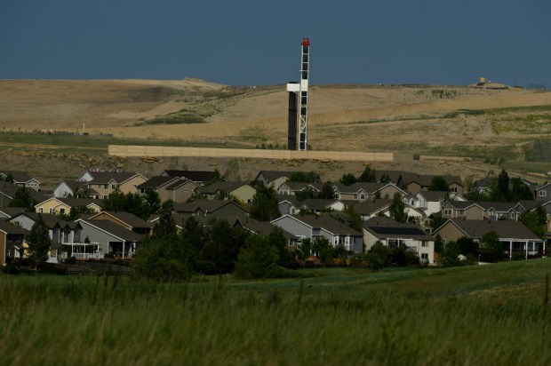 A drilling operation sits near housing subdivisions in Erie on June 7, 2017.