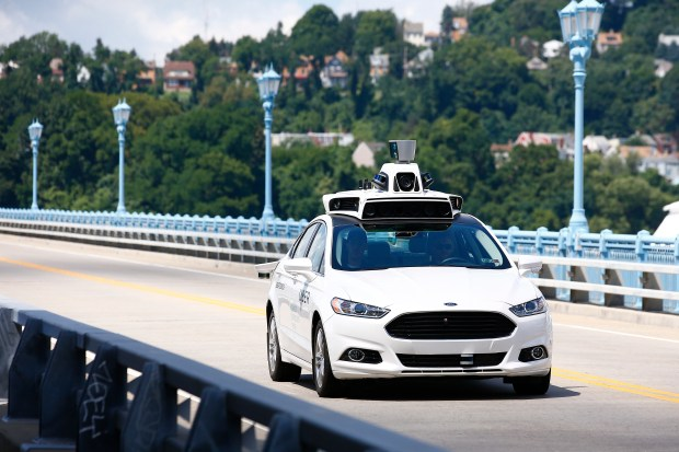 Uber employees test a self-driving in Pittsburgh on Aug. 18, 2016. Uber suspended all of its self-driving testing on Monday after what is believed to be the first fatal pedestrian crash involving the vehicles. Police in a Phoenix suburb said one of its self-driving vehicles struck and killed a pedestrian overnight Sunday.