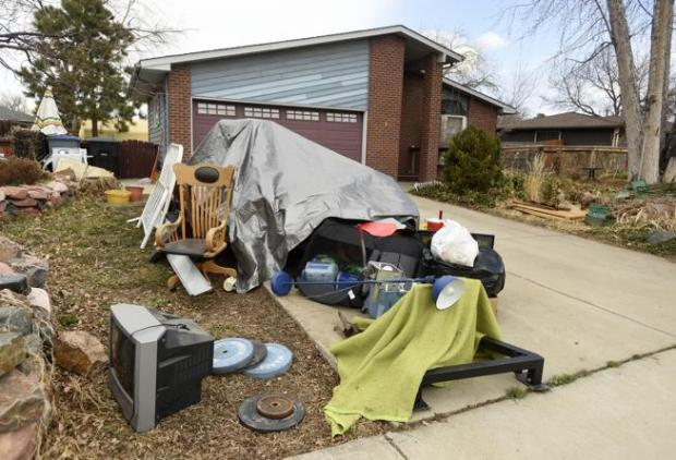Items from Mary Andrews' house are in her yard and driveway at 14 Texas Lane in Longmont on Monday.