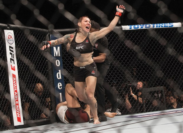 "Cris ""Cyborg"" Justino celebrates after defending ..."