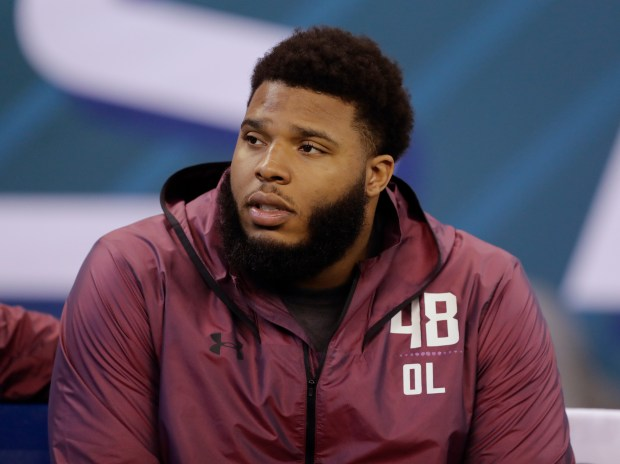Georgia offensive lineman Isaiah Wynn watches during the NFL football scouting combine, Friday, March 2, 2018, in Indianapolis. (AP Photo/Darron Cummings)