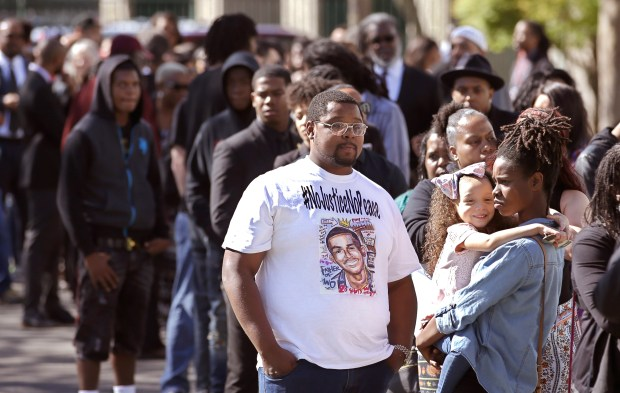 A long line of mourners wait in line to enter the Bayside of South Sacramento Church  for the funeral of Stephon Clark, Thursday, March 29, 2018, in Sacramento, Calif.  Clark, who was unarmed, was shot and killed by Sacramento Police Officers, Sunday, March 18.